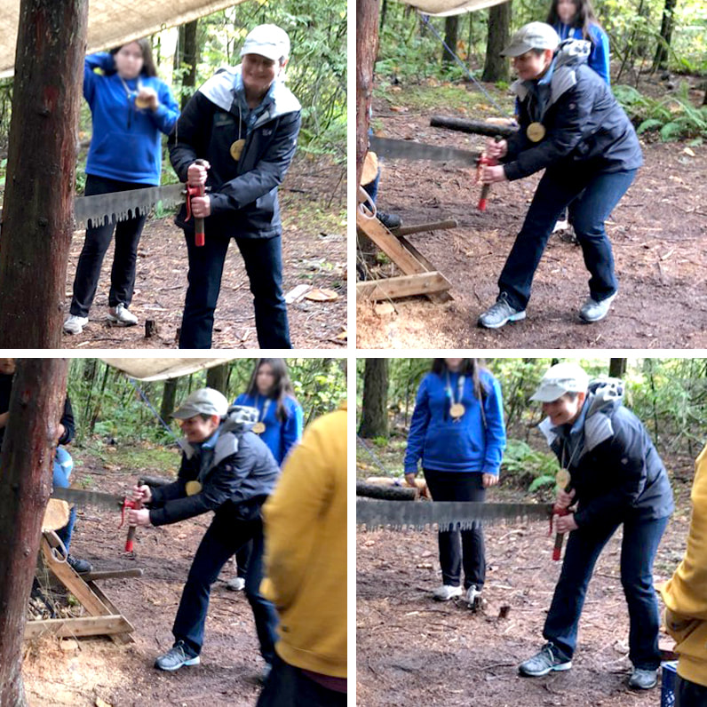 Senator Elizabeth Steiner learning to use the crosscut saw at Outdoor School.