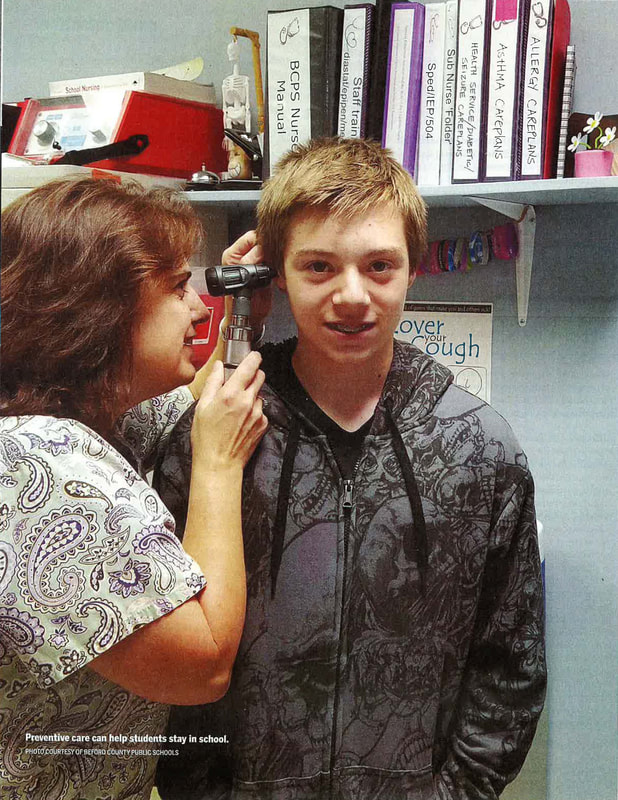 Nurse checking student's ears