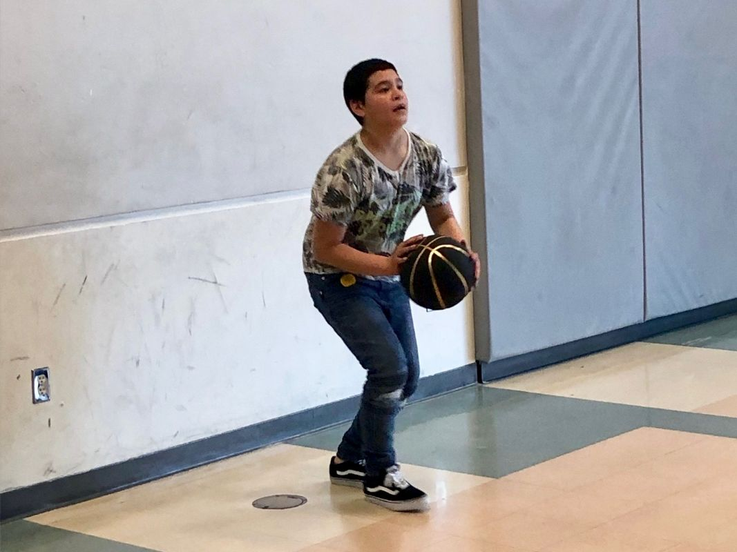 Arata Creek student playing basketball