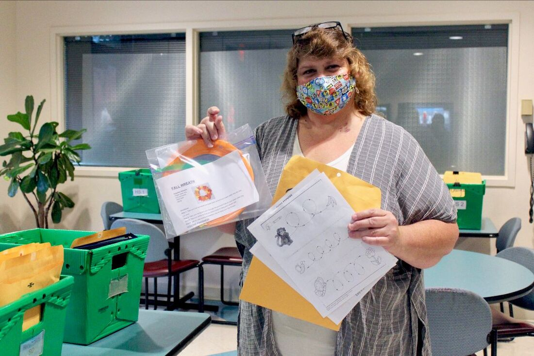 Mary Smith, the Administrative Assistant at Wheatley, assembles student packets to be sent from the Multnomah Education Service District building, Nov. 6, 2020.